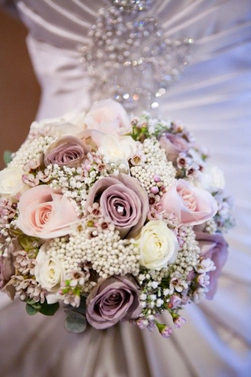 Gorgeous wedding bouquet in violet, pink, a touch of green and of course, white.