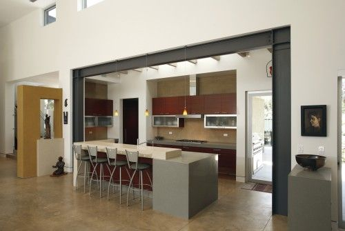 exposed steel beams, concrete counters