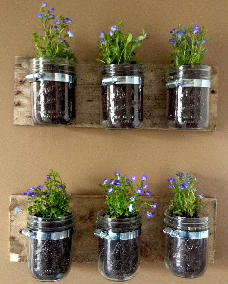 PAINTED Mason Jar Hanging Wall Planter. $27.00, via Etsy.