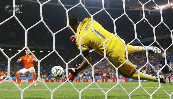 World Cup 2014: The Netherlands vs Argentina Semi-Final Highlights - Argentina's Romero saves the penalty of Vlaar of the Netherlands during their shootout in their 2014 World Cup semi-finals at the Corinthians arena in Sao Paulo. DOMINIC EBENBICHLER/REUTERS