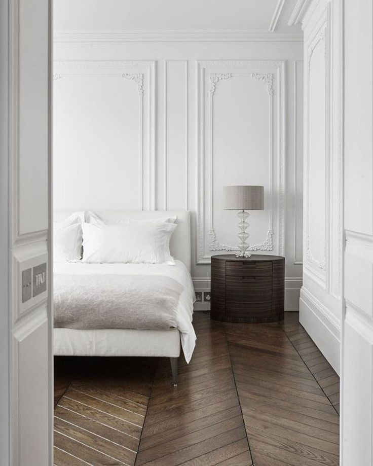 white wall details, wood chevron floors, mix of old & new