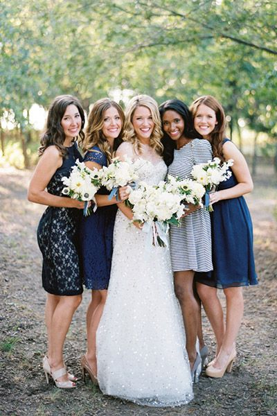 Want your bridesmaids to choose their own dresses? A little variation in the dress hue is perfectly fine! Various shades of blue work especially well together.