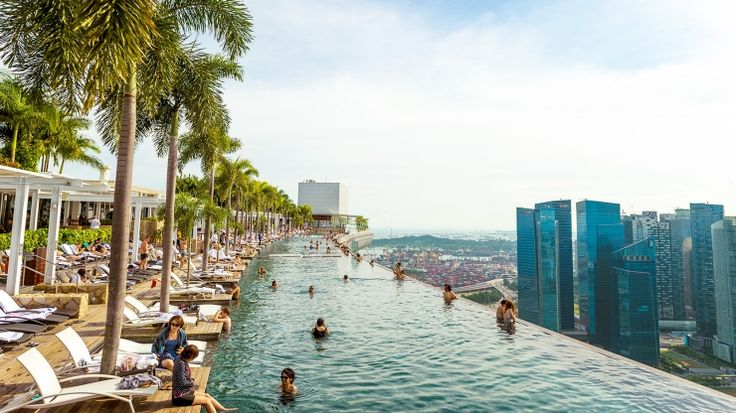 Take in unparalleled views of the city at Marina Bay Sands'® rooftop infinity pool.