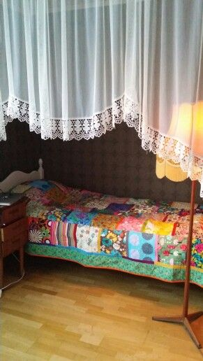 Awesome colourful quilt i was given. Brightens up my little alcove and went perfect with my vintage mustard lamp. :)