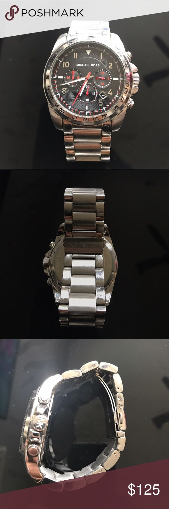 Micheal Kors Watch MK silver men's watch. Although a man's watch, looks very good a women wrist. Fit for a smaller wrist. Michael Kors Accessories Watches
