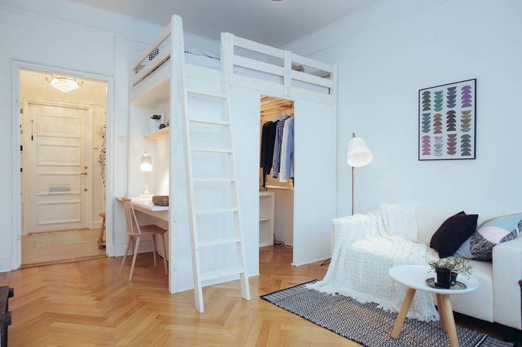 studio apartment with loft bed and clever storage studio