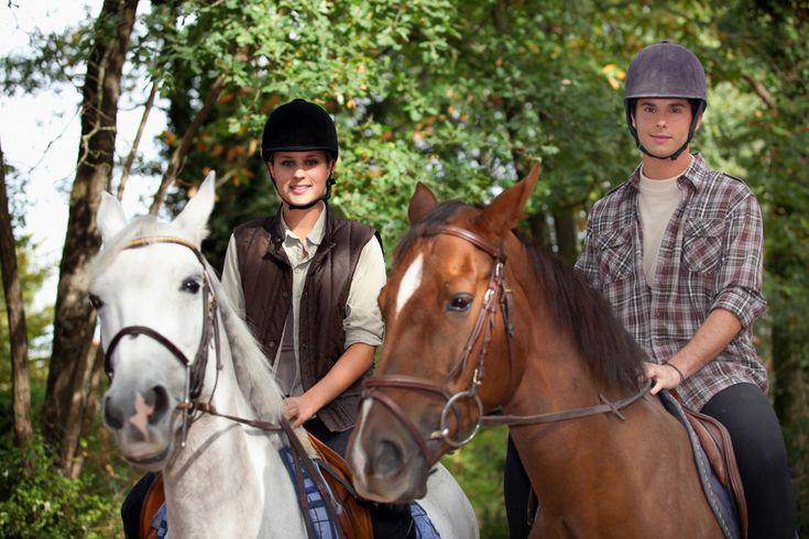 A young couple enjoying Cades Cove horseback riding.