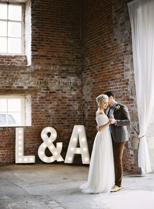 marquee monogram lighting in industrial loft wedding venue
