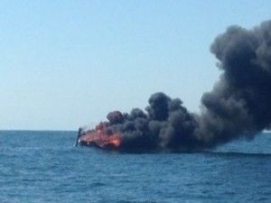 8-10-15 Boat burns and sinks off OC beach -- U.S. Coast Guard photo