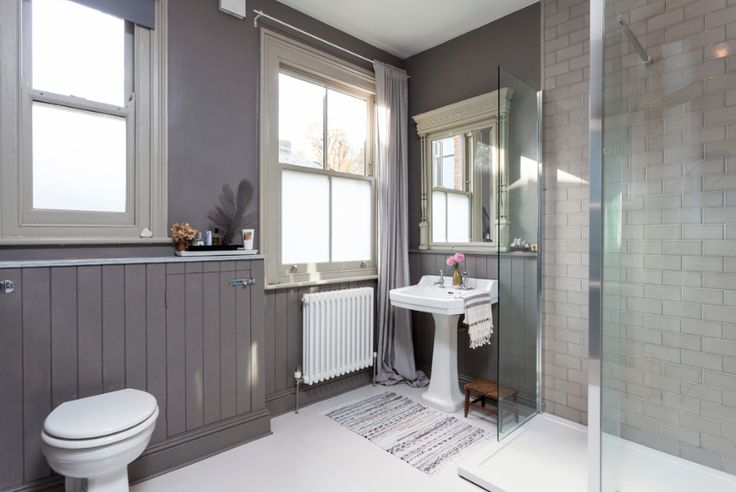 Tongue and groove paneling is a tried and tested way to clad bathroom walls to hide a tangle of pipes. If you've gone for this practical option, you can move with the trends by repainting the paneling as color fashions come and go. This season, gray is still going strong …