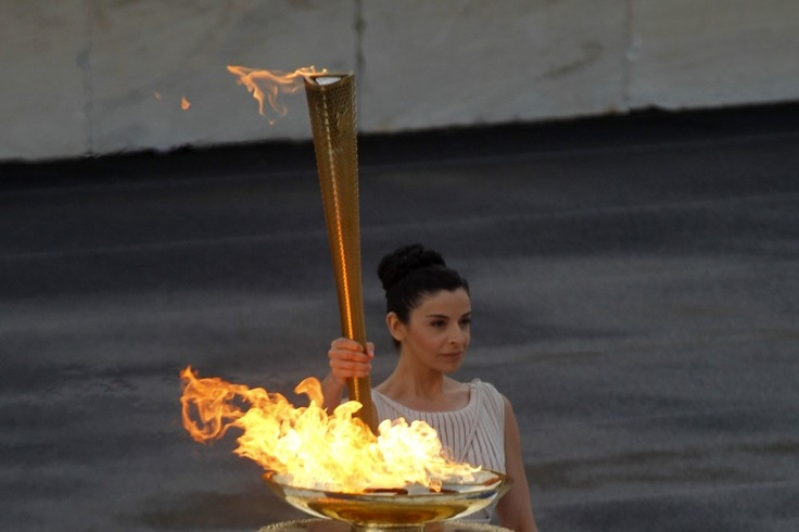Greece... London Olympics Flame...High priestess Ino Menegaki raises the torch with the Olympic Flame,  during a handover ceremony  for the Olympic flame at Panathenaean stadium in Athens, Thursday, May 17, 2012. (AP Photo/Kostas Tsironis)
