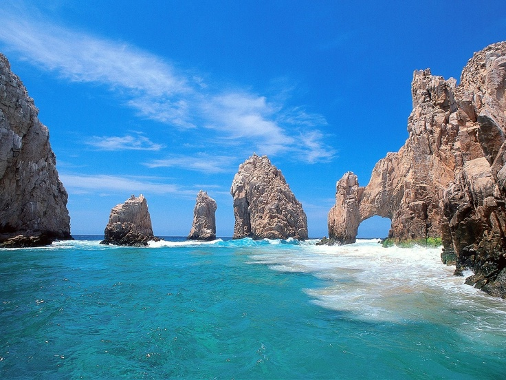 """Cabo San Lucas, Mexico.  This picture is taken at Lands End of the Baja penisula.  This is the famous ARCH.  We kayaked from the shore to this point.  It is where the Sea of Cortez meets the Pacific Ocean. We stayed at THE ONE AND ONLY in Cabo.  It was more than amazing!  A more affordable and more """"happening"""" place is down at the cabo beach area.  Lots of festive fun  in the sun on the beach and shopping.  Food is great!  Loved Cabo!"""