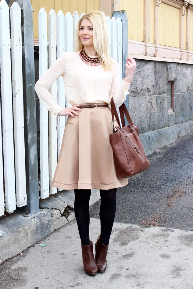 Secret Wardrobe blogger Anna-Maria wearing powder shades: white shirt, skirt in powder beige, brown leather.