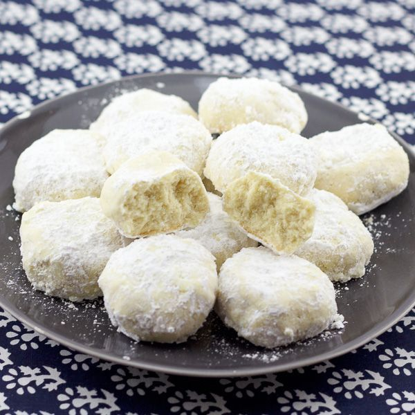 These delicious Greek holiday cookies, know as Kourambiethes, are covered in powdered sugar, easy cookies to make, and something the whole family will love this holiday season.