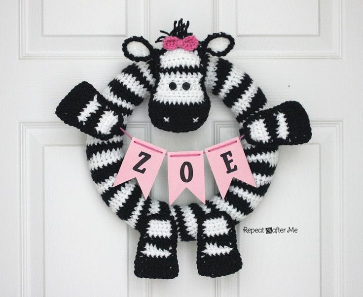 Repeat Crafter Me: Crochet Zebra Wreath - this would be a great alternative to the overtly holiday themed wreaths for a multi-faith family