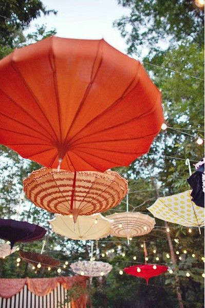 DIY Hanging Umbrellas for shade. Colorful, creative and functional!