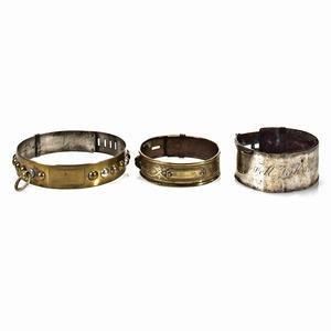 Group of three Victorian dog collars of various metals Sold for US$ 1,159 inc. premium