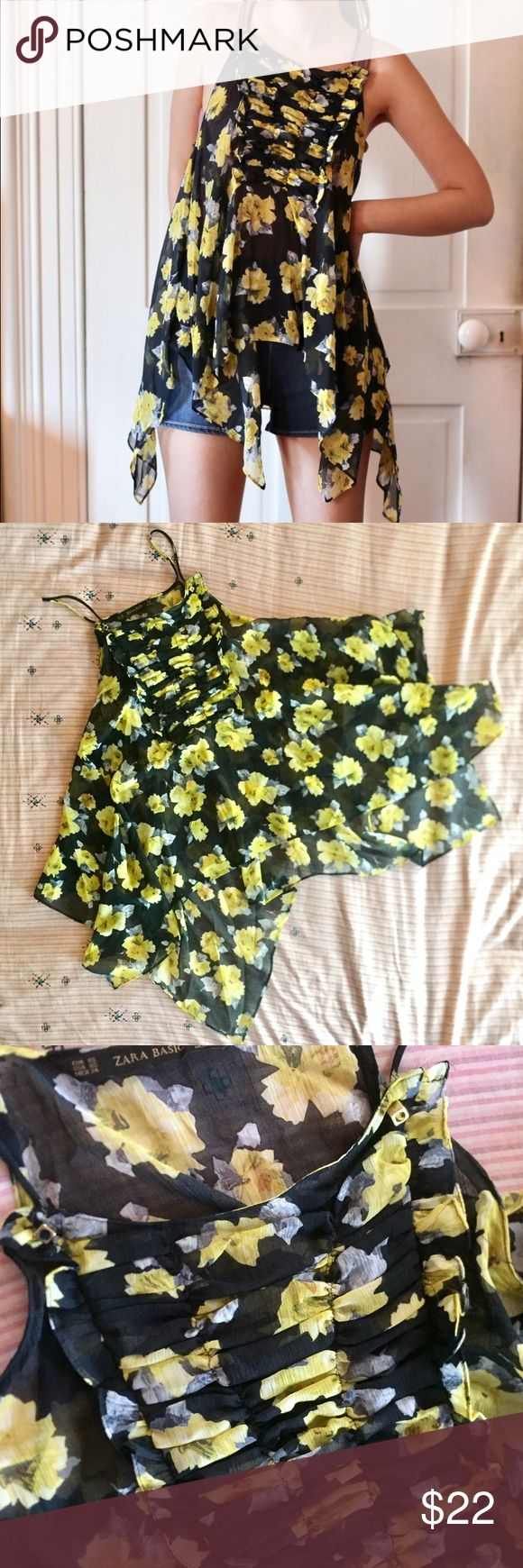 "Zara Asymmetrical Hem Floral Strappy Top A top in a somewhat halter style with spaghetti straps and a ruffled bib detail on the front where the straps are held in place with gold cube beads. Lovely flowy Asymmetrical Hem and material of a dark color with gorgeous yellow flowers. Length not counting the straps varies from about 17"" to 29"" but it's hard to measure accurately because of the uneven bottom. 100% poly and new condition-- never worn! I think it fits more like an S Zara Tops"