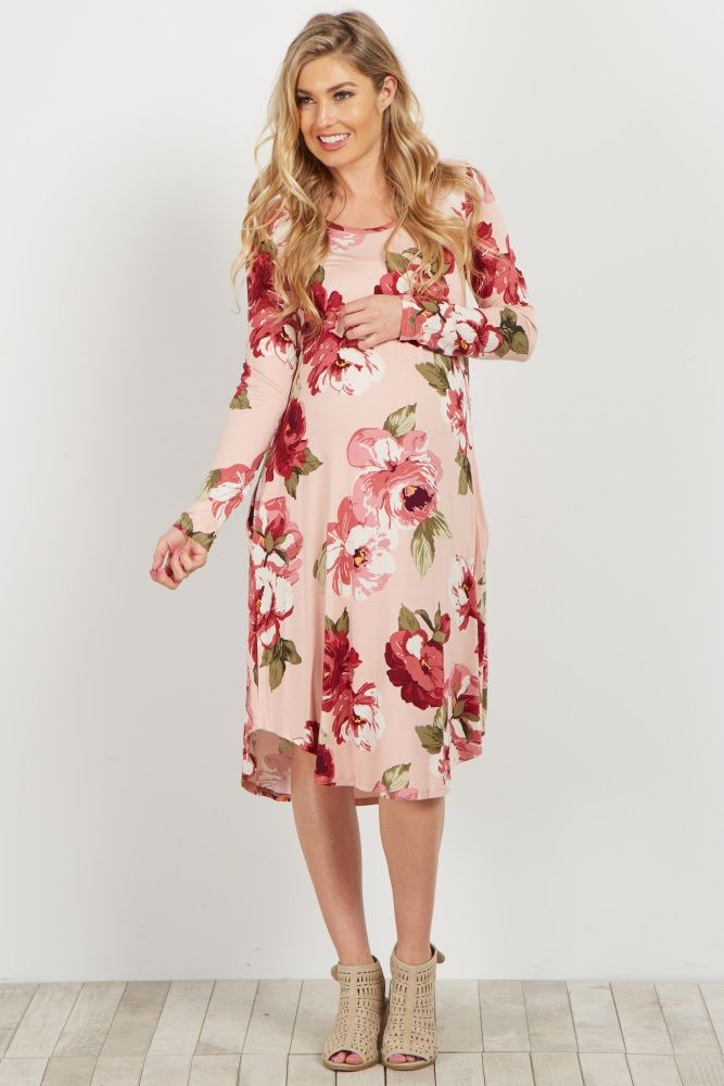This adorable floral maternity dress is a must-have this season. It's the perfect piece to dress up or down. You'll feel cute and comfy and you won't want to take it off! Pair with your favorite booties and a statement necklace for a complete outfit.