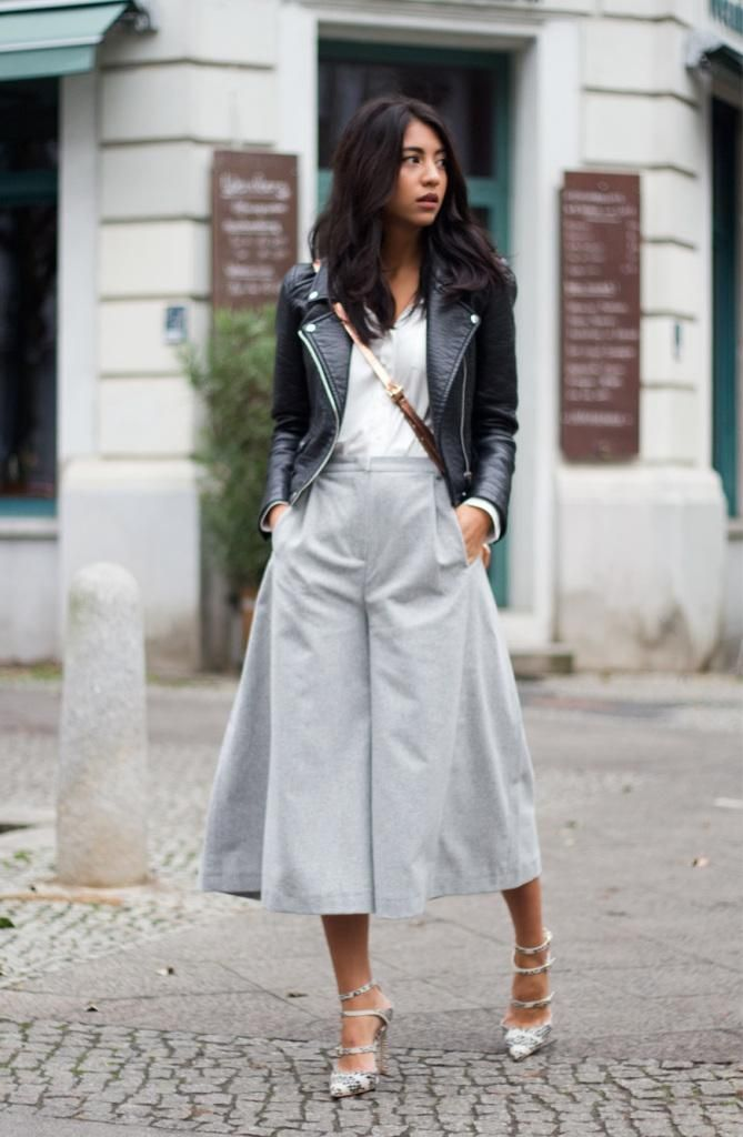 21 Ways to Wear the Culottes Fashion Trend - voluminous gray culottes styled with an edgy black leather jacket + ladylike heels