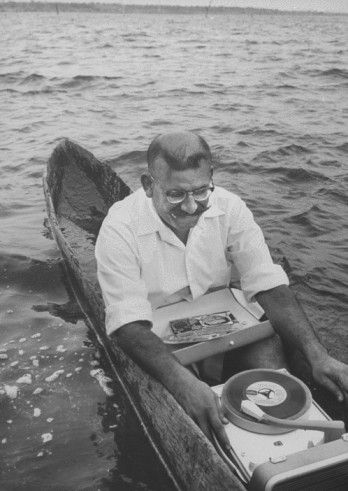 Old man in the sea listening to records