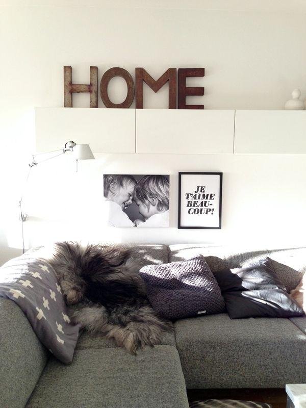 grey sofa & white wall shelves in living room