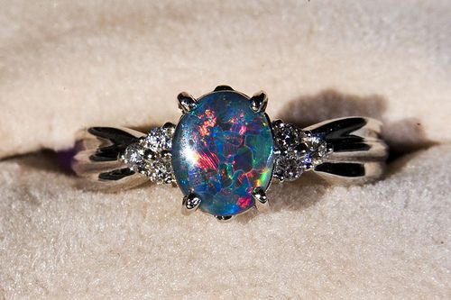 Black opal engagement ring. Diamonds are too common.
