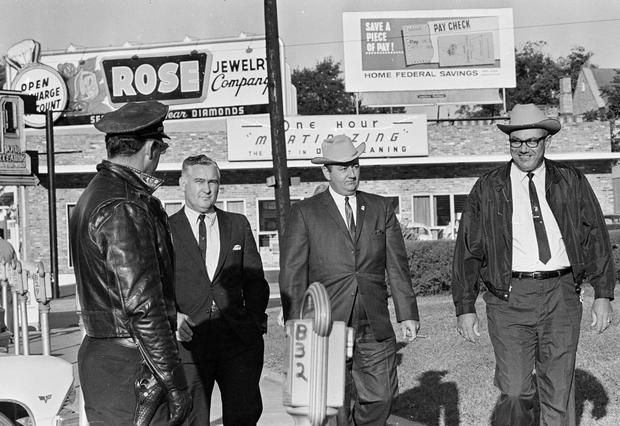 Neshoba County Sheriff Lawrence A. Rainey, right, and deputy Cecil Price, center, pass a Meridian policeman en route to court on the third day of their conspiracy trial in the slaying of three civil rights workers in Meridian, Miss., Oct. 11, 1967. At left is Richard Andrew Willis, another of 18 people charged under an 1870 federal law of conspiring to deprive Freedom Summer activists Andrew Goodman, Michael Schwerner and James Chaney of their civil rights. Credit: AP Photo/Jack Thornell