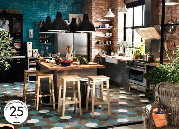 bright blue color, stainless island, light fixtures, stools....