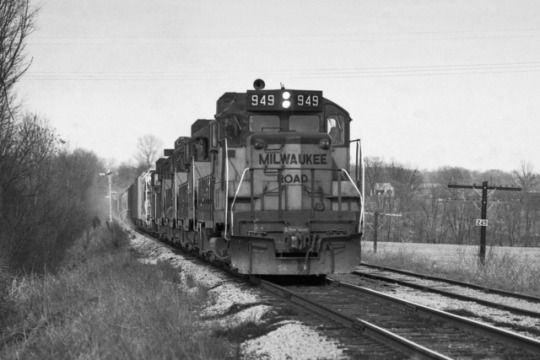 This is a southbound train of the Milwaukee Road running on the Louisville & Nashville, former Monon, just south of Bedford, Indiana.    The Milwaukee Road won trackage rights on the L&N between Bedford and Louisville when the Monon was subsumed into the larger railroad in 1971.     Two images by Richard Koenig; taken in the mid- to late-1970s.