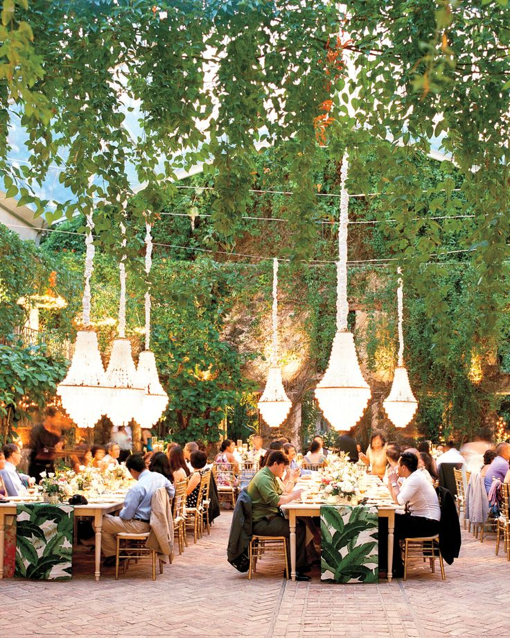 """WHAT ELEMENTS WILL MAKE THE BIGGEST IMPACT ON AMBIENCE? """"Lighting is an important factor in setting the mood for your event. When in doubt, opt for 'soft amber' bulbs; they're classic and flattering. Candles are a part of the lighting design and even just a few votives on a dining table can make all the difference."""