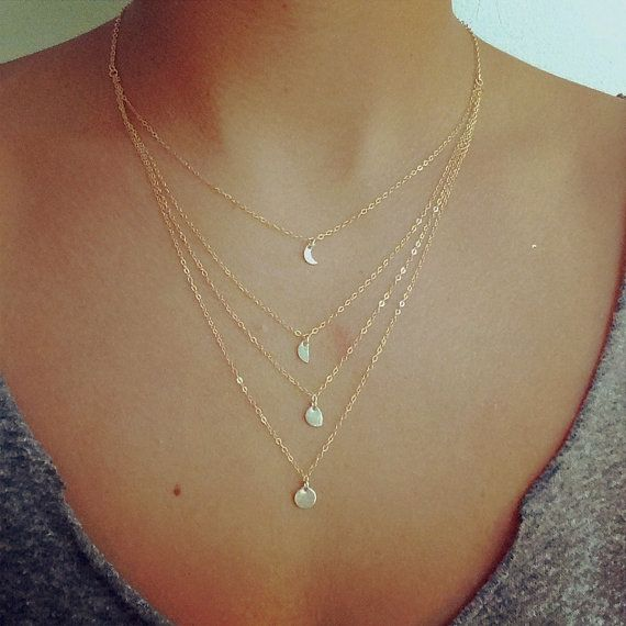 Moon lovers- Love by the moon in this beautiful, delicate handmade layered necklace. There are four tiers, and the shortest chain hangs at ~ 16 with