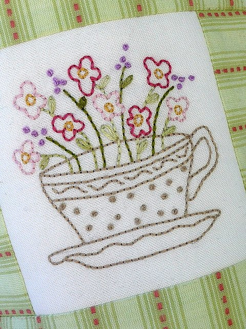 Close-up of the tea-cup embroidering pattern.