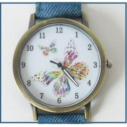 Štýlové hodinky s motýlikom doplnené modrým remienkom z eko kože :)