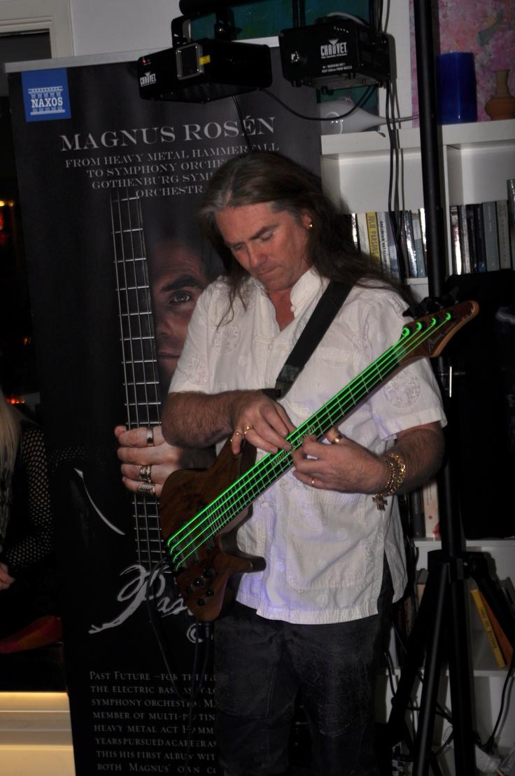 Playing the bass like a virtuoso.