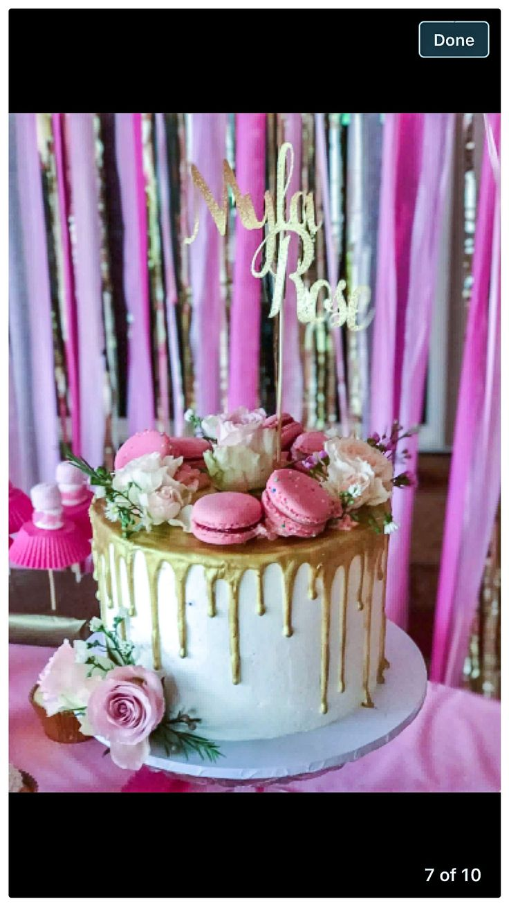Golden drip cake with pink accents