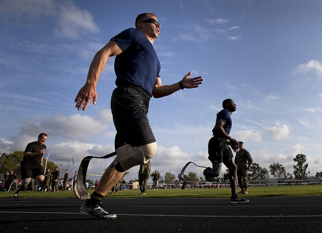 Capt. Jonathan Disbro and Cpl. Kionte Storey, Wounded Warriors with the West Team, fight for the lead in the 200m race during the 2012 Marine Corps Trials, hosted by the Wounded Warrior Regiment, at Marine Corps Base Camp Pendleton, Calif - #Marines