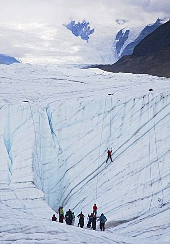 An ice climbing class on the Root Glacier in Wrangell-St. Elias National Park…