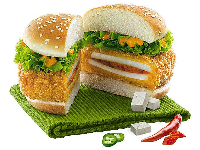 The 10 Weirdest International Fast Foods of 2014 | PANEER SANDWICH WITH CREAM SAUCE | Who's chicken now? KFCs in India served up the Paneer Zinger, a crunchy, double-layered paneer (cheese) patty filled with a spicy, creamy sauce and topped with lettuce on a sesame bun.