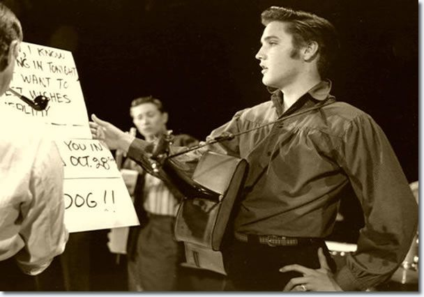 "Elvis Oct. 1956 (first appearance) going over his closing lines before singing ""Hound Dog"" on his first appearance on the Ed Sullivan Show."