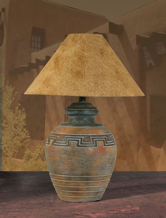 ~ Rustic Southwestern lamp.  Love the shade, its texture mimics suede.  The base is beautiful scrolled work reminiscent of Native American style of the southwest.  A lovely adornment on any sofa, end table or home office desk. ~