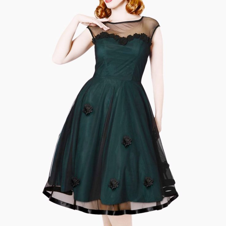 Show-stopping 1950s-style forest green party dress with a rosette trimmed sweetheart neckline and sheer illusion overlay. Classic fit-and flare silhouette with a nipped waist and swing skirt.