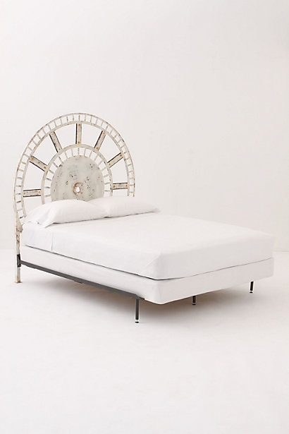 I want to recreate this headboard with an antique wagon wheel.  If only I knew where to find those...