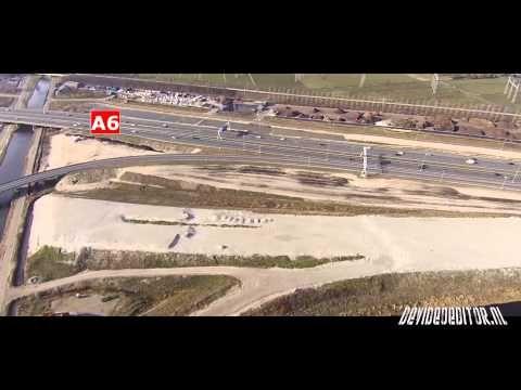 #Wegenbouw   http://www.devideoeditor.nl http://www.vpromotions.nl   Met deze #drone beelden kun je goed zien hoe ver de werkzaamheden zijn bij de verbreding #A1 #A6. Veel woningen en kleine oude boerderijen hebben hiervoor plaats moeten maken. Opvallend is dat er nog één boerderij langs de Amsterdamsestraatweg 87 Naarden in takt is. Vooral de ligging van deze boerderij tussen de snelweg en de toekomstige afslag A1 naar de A6 is best wat vreemd.
