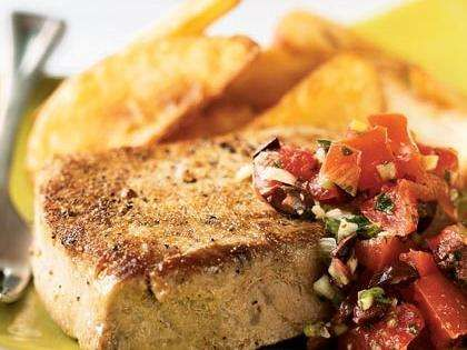 Coriander has a lemon-sage flavor that complements the tuna and the fresh tomato sauce. Serve with a side of refrigerated potato wedges, roasted according to package instructions.