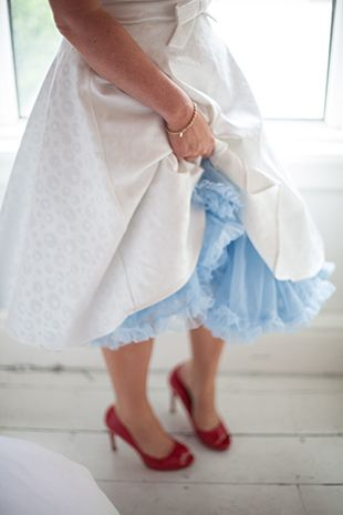 50s style wedding dress with fun baby blue petticoat underneath and red peeptoe shoes - a bride with style!| www.onefabday.com