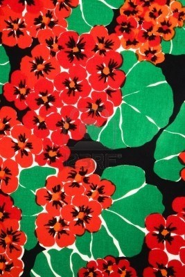 vibrant red geraniums and green leaves,  vintage fabric