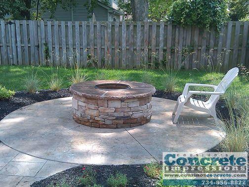 concrete patio with fire pit | Cousinos Concrete Impressions - Stamped Concrete fire pits