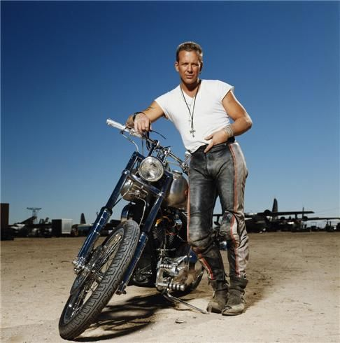 """Mickey Rourke Bike And Tee by Terry O'Neill. Former boxer and American film actor Mickey stars in 'Harley Davidson and the Marlboro Man', 1991. Limited Edition C-Print Signed and Numbered - 16"""" x 16"""" / 20"""" x 20"""" / 24"""" x 24"""" / 30"""" x 30"""" / 40"""" x 40"""" / 48"""" x 48"""" / 60"""" x 60"""" / 72"""" x 72"""" - For questions or prices please contact us at info@igifa.com"""