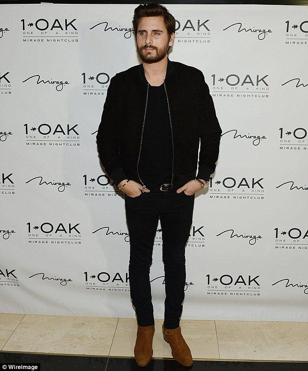 Antics: A new report by Us Weekly claims Scott Disick, 31, is in a dark place and is partying nonstop, pictured at Las Vegas' 1OAK nightclub, housed in the Mirage Hotel and Casino, on Saturday night